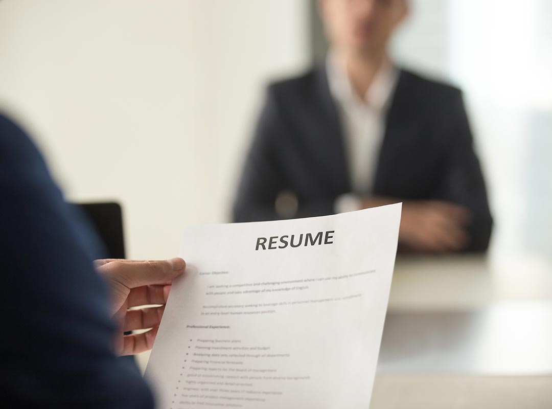 A person reading a resume
